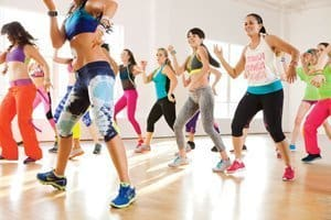 A group of women performing a Zumba workout