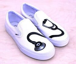 A stethoscope painted on some Vans nurses shoes