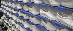 Various different types of white nursing shoes