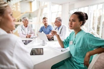 Nurses discussing at the table