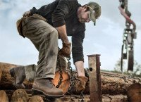 A man wearing Timberland pitboss boots at work