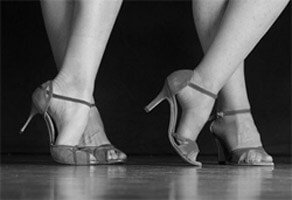 Women wearing high heeled latin dance shoes
