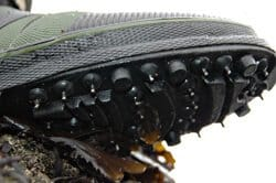 Metal studs in the sole of wading boots