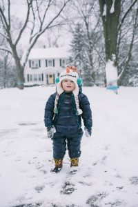 baby boy or toddler in snow