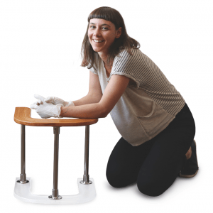 mother sitting on floor leaning on table