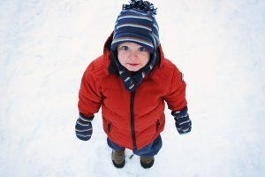 dress-warm-in-layers, child playing in snow