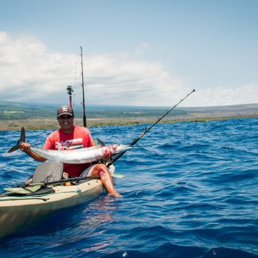 Andy Cho.  Extreme kayak fishing in Hawaii with da Aquahunters.
